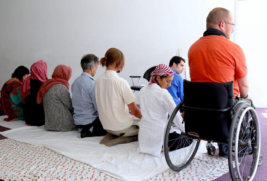 People of all genders pray side by side
