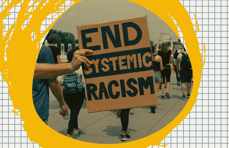 A graphic of a yellow circle around a photo of a sign that says 'End systemic racism'